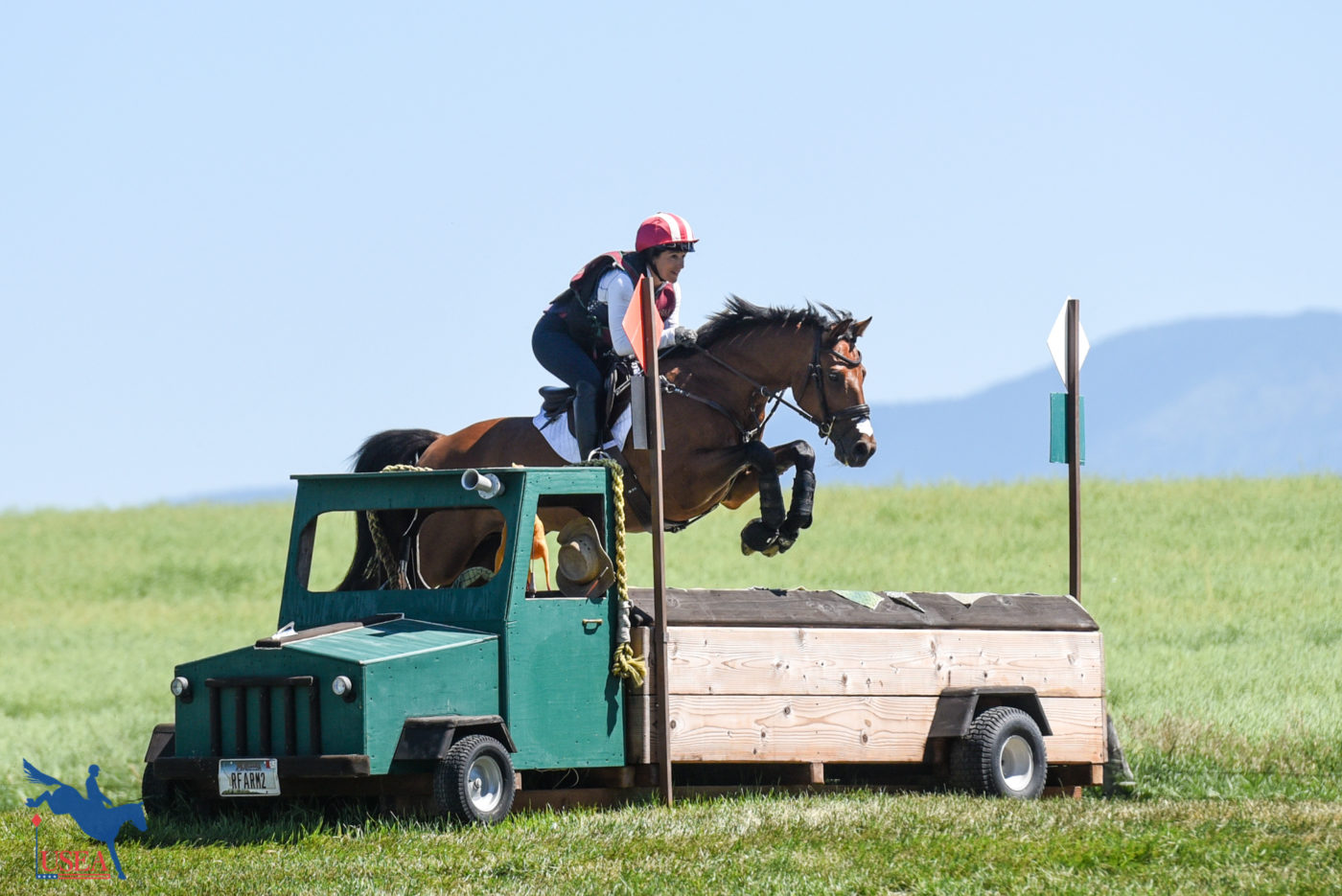 An endless backdrop of blue sky is the perfect place for Can Be Sweet to show off his jumping skills. USEA/Leslie Mintz Photo.