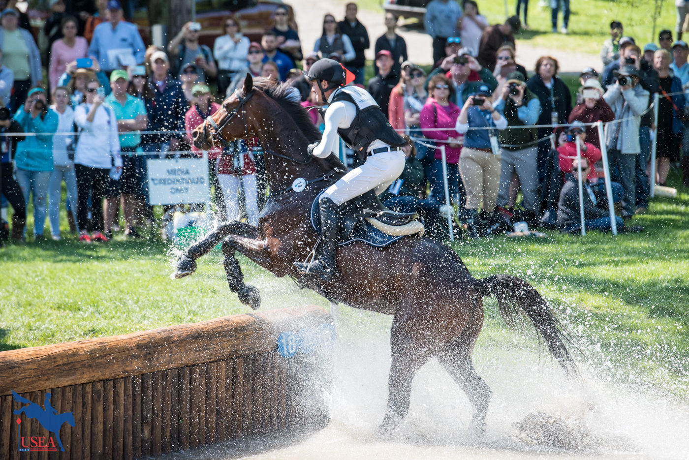 Splashing up the bounce bank. USEA/Leslie Mintz Photo.