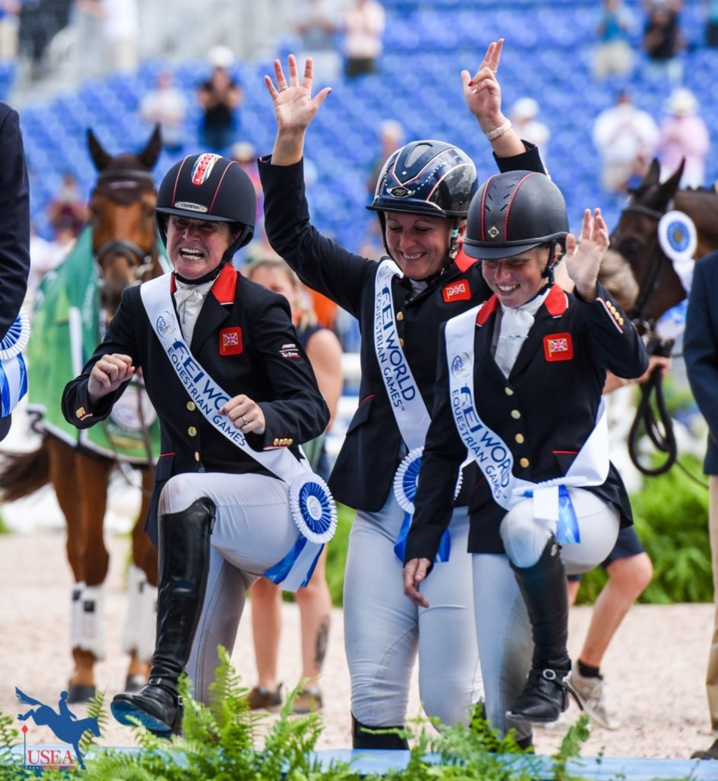 The British Team celebrating their (literal) climb to the top of the podium. USEA/Leslie Mintz Photo.