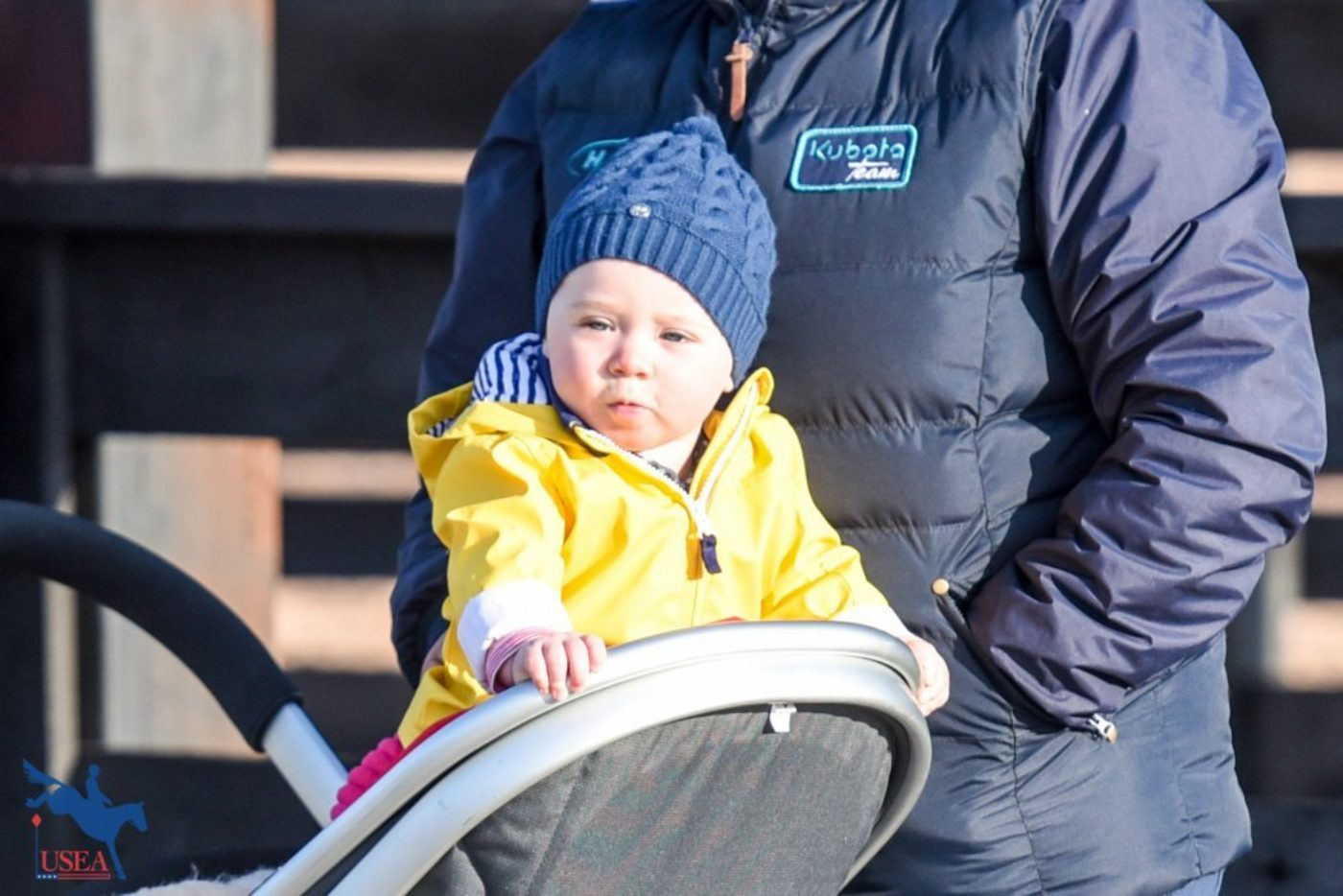 Andrew Hoy's daughter watches the jog with interest.