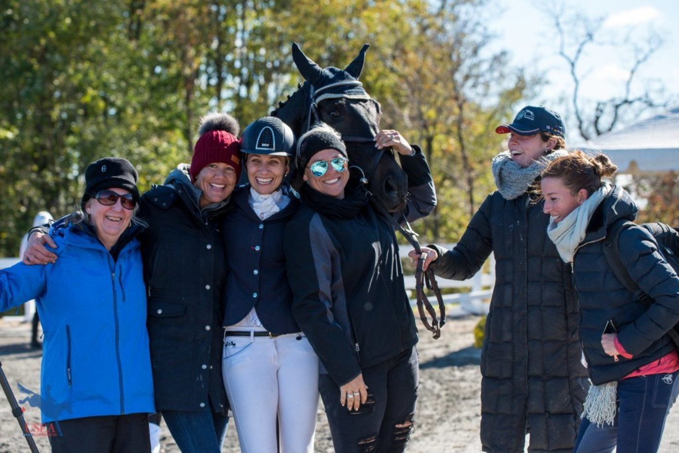 "Frankie Thieriot Stutes celebrating her victory with some of the ""Westies"" in attendance at Fair Hill. USEA/Jessica Duffy Photo."