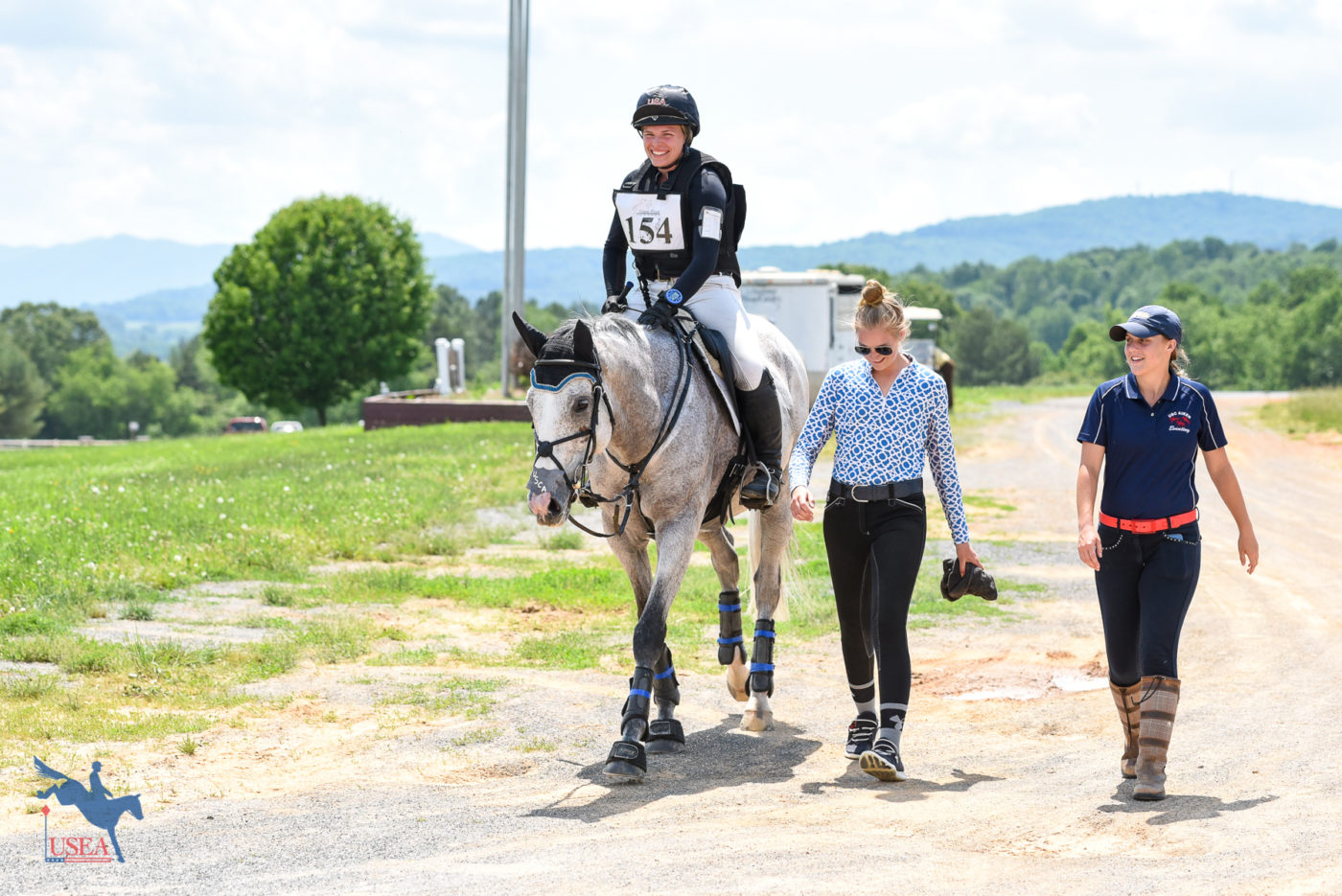 Members of the USC Aiken Eventing Team heading back to the barn with Grace Fulton and Yippee Ki Yay after cross-country. USEA/Jessica Duffy Photo.