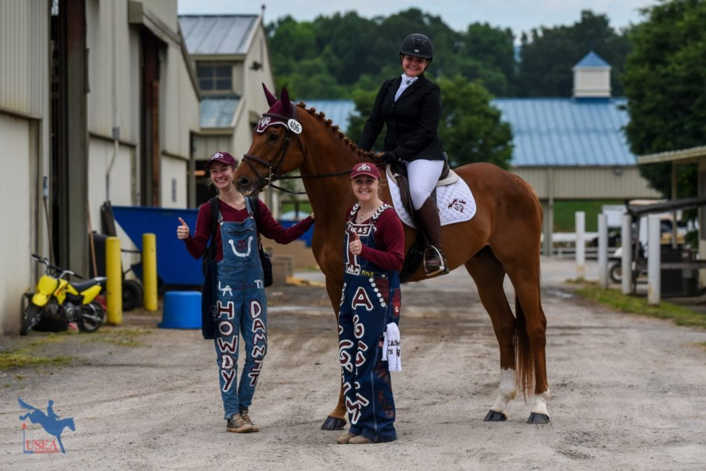 "Erin Posey and Answered Prayers heading out for their dressage ride with their Texas A&M ""Pit Crew"". USEA/Jessica Duffy Photo."
