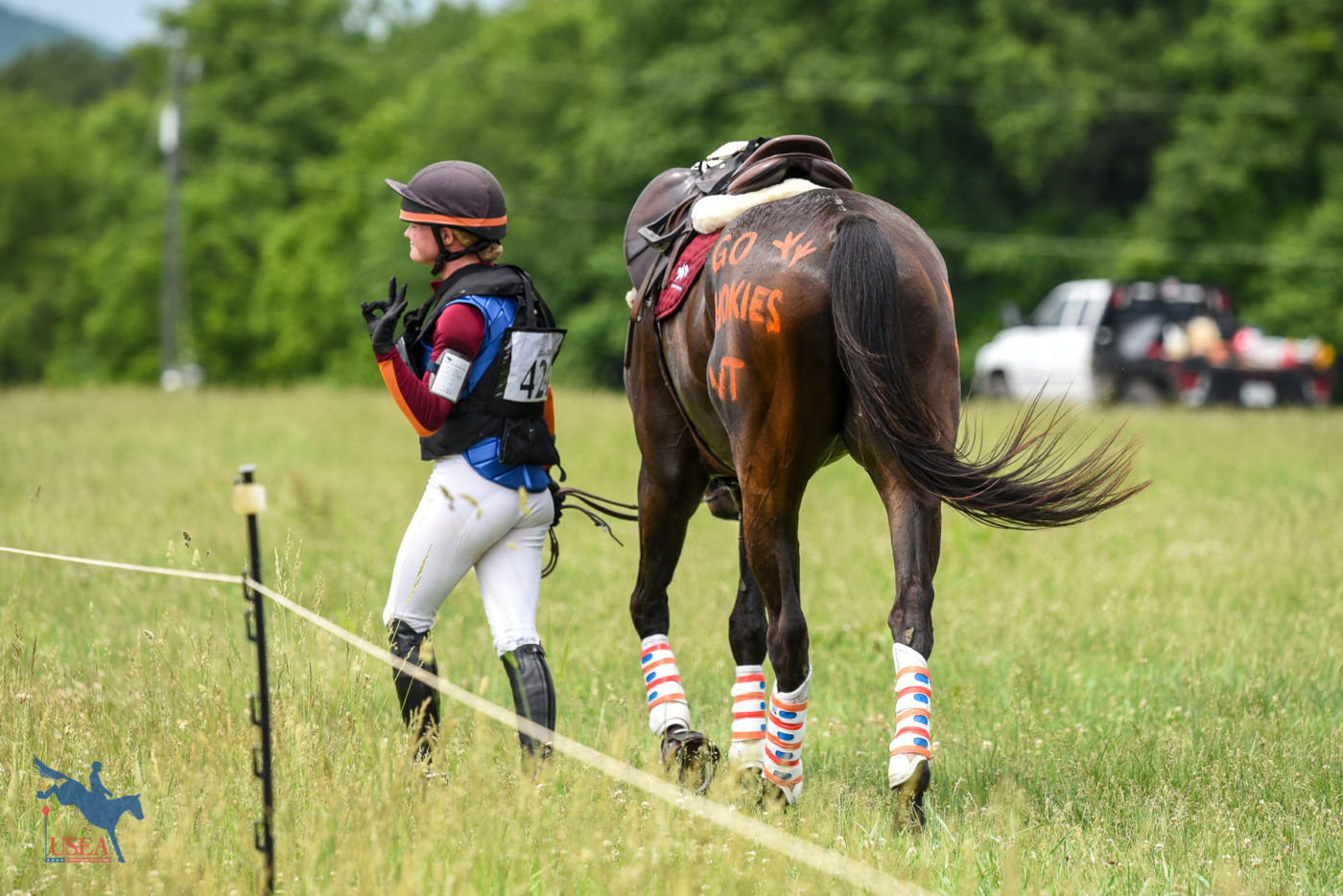 Virginia Tech's Holly Newberne celebrating a great cross-country ride aboard FGF Overzealous. USEA/Jessica Duffy Photo.