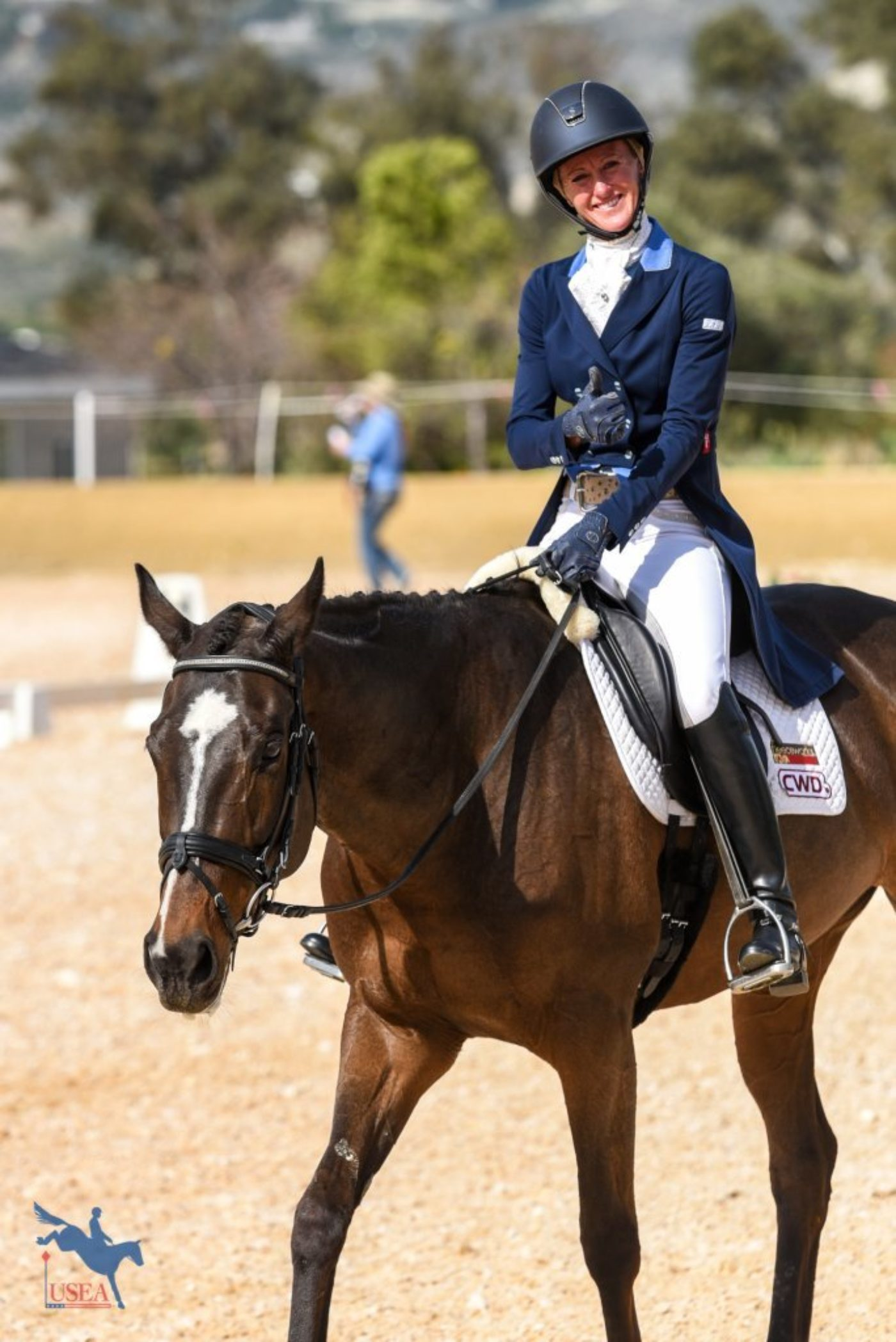 All smiles from Andrea Baxter at the conclusion of her dressage test with Indy 500. USEA/Jessica Duffy Photo.