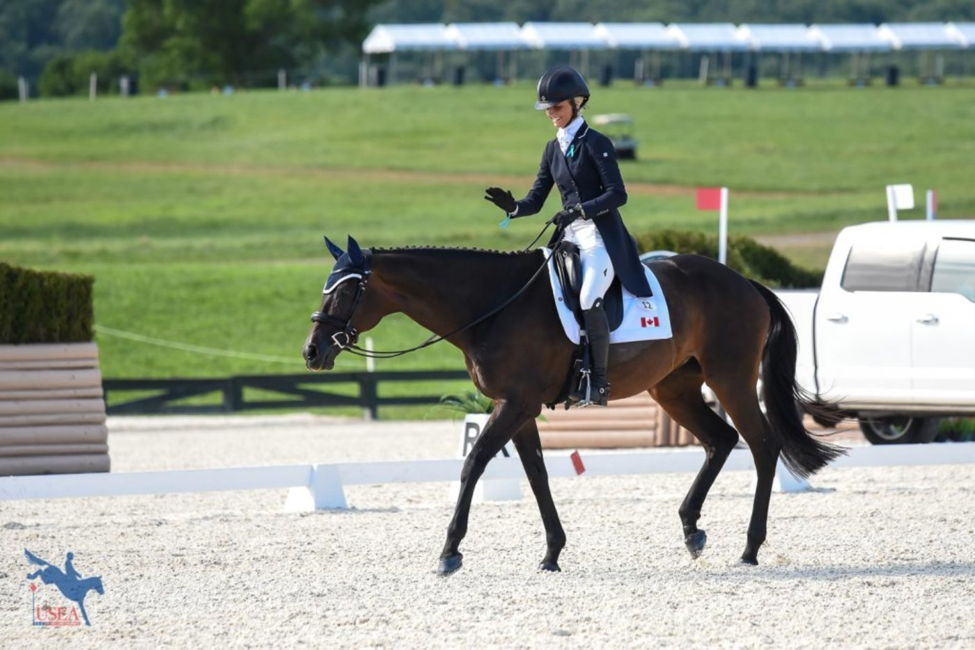 Shelby Brost loving on Crimson after their dressage test. USEA/Jessica Duffy Photo.