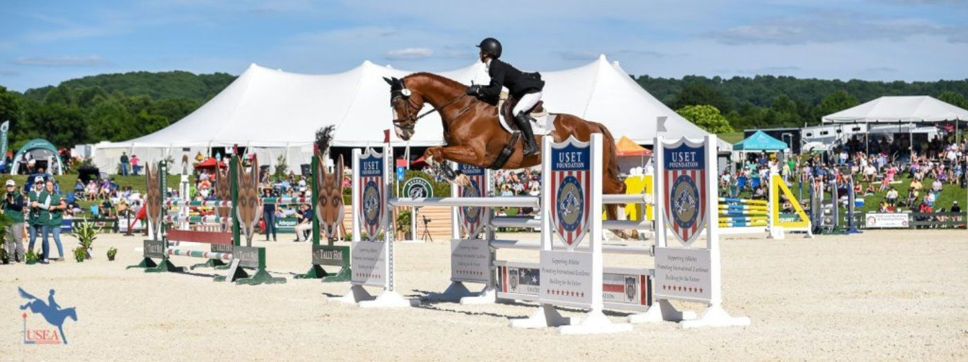 Cornelia Dorr and Louis M show jumping in the Fleming Farm Arena in front of the crowds. USEA/Jessica Duffy Photo.