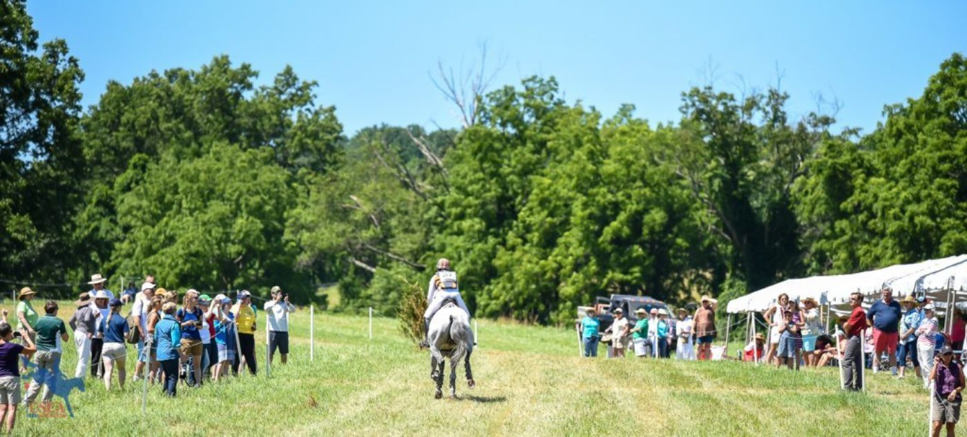 Lauren Kieffer and Paramount Importance galloping away through the crowds. USEA/Jessica Duffy Photo.