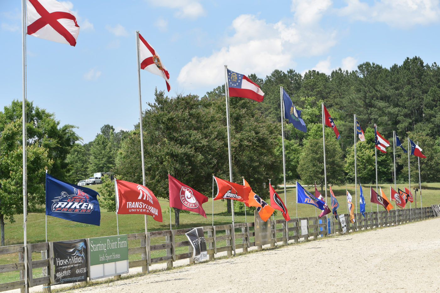 The State flags and College/University flags in the main arena. USEA/Kate Lokey photo.