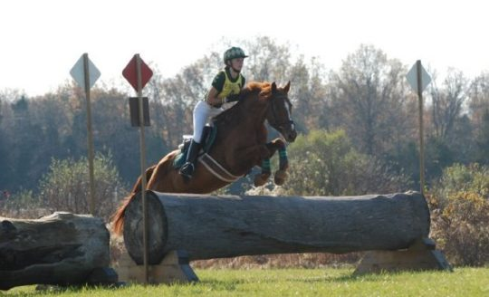 Erin Kellerhouse and Woodford Reserve flying across the country. USEA/Jessica Duffy Photo.